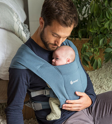 Dad with Baby in the Embrace Newborn Carrier